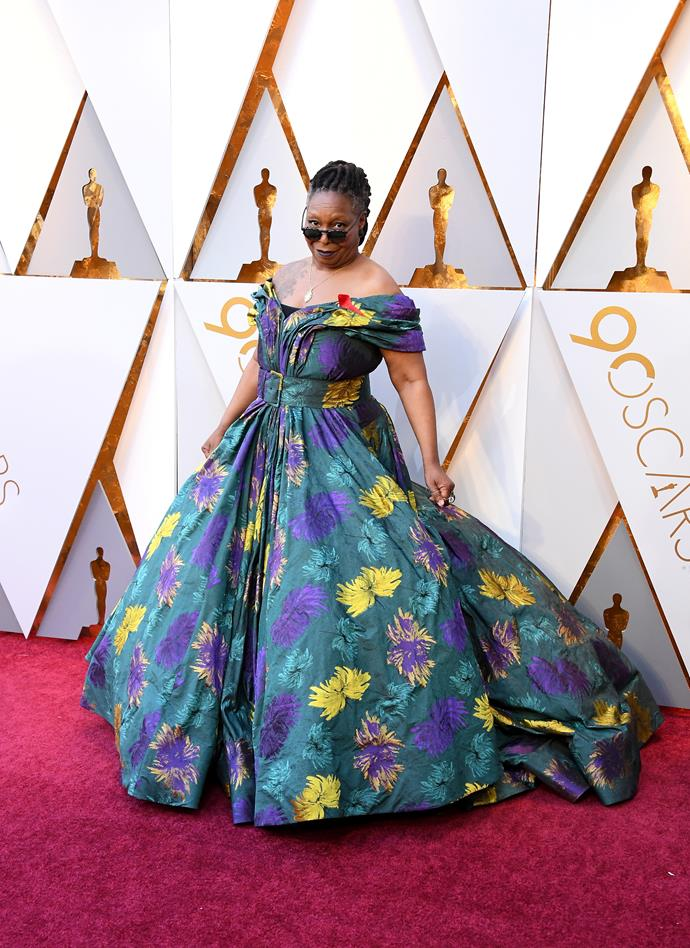 Whoopi Goldberg is one of a kind and we truly love this whacky outfit, we wouldn't expect anything less from Ms  Goldberg.  She told presenters she wanted to be as comfy as possible and under that dress she is sporting a pair of hiking boots. We love it!