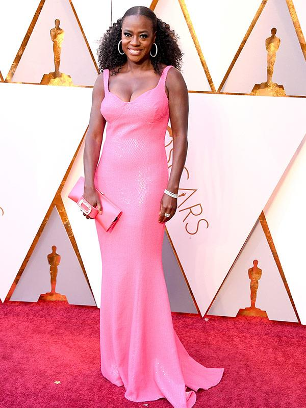 Viola Davis isn't afraid to pack a punch of colour in a fuchsia dress by Michael Kors and big, statement-making hoops.