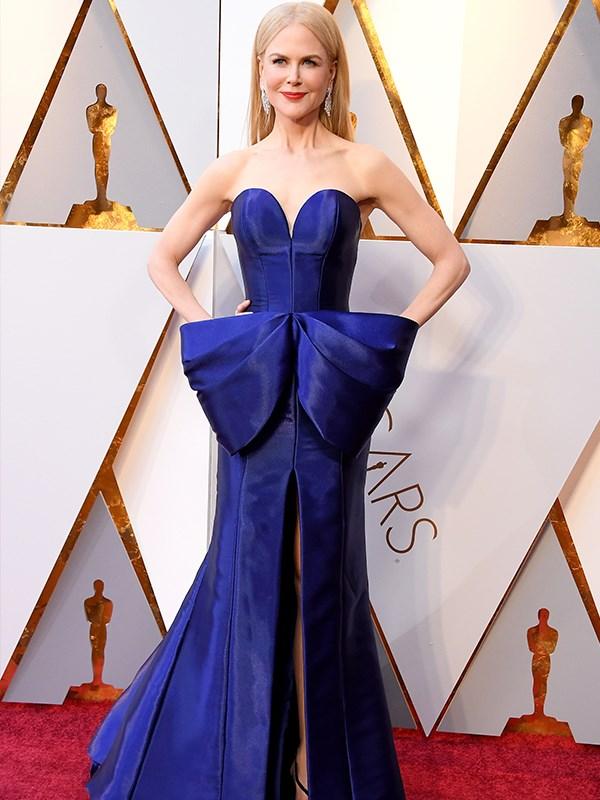 The statuesque Aussie wore a deep indigo gown.