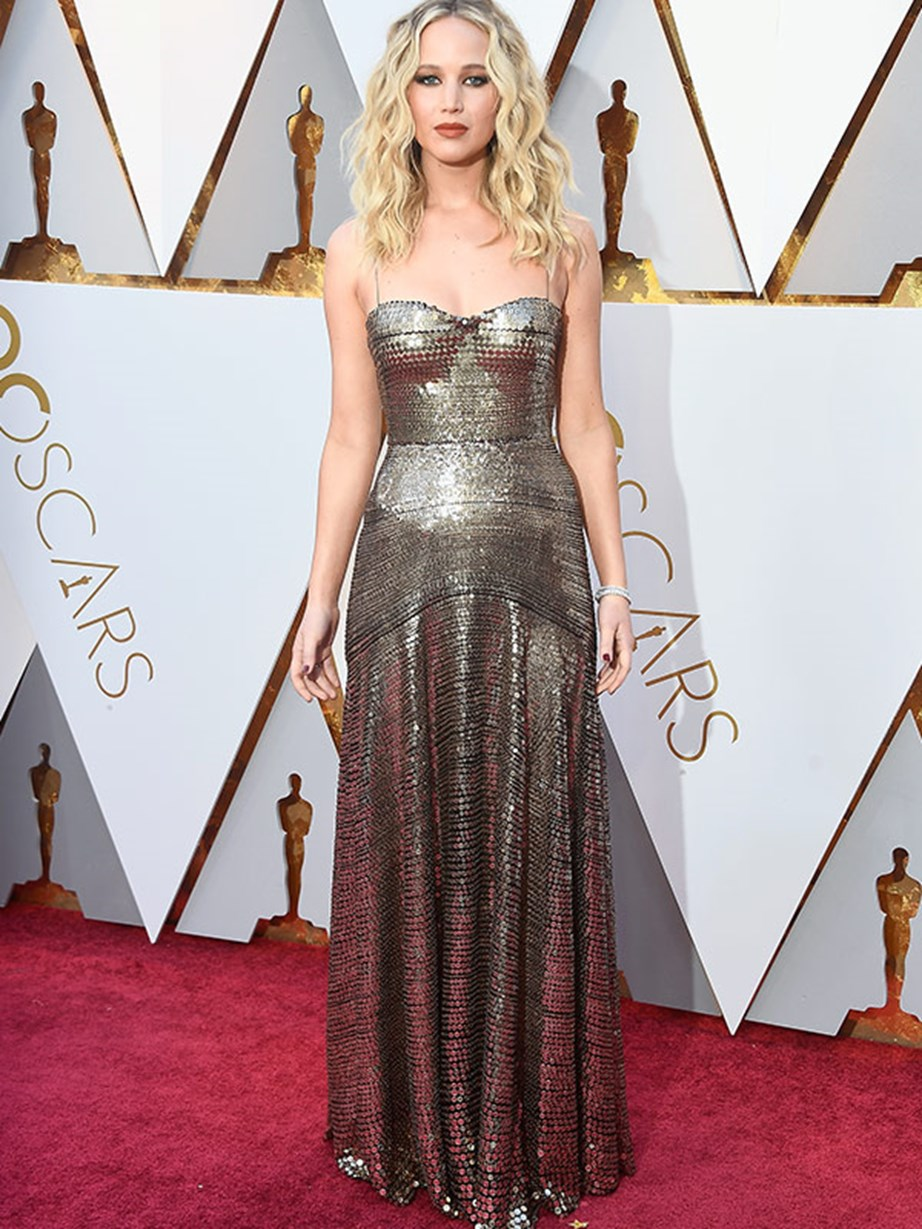 Jennifer Lawrence looks like a living doll in Dior.