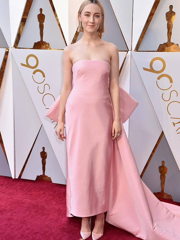 Best Actress nominee Saroise Ronan opts for a strapless pink dress with a feature bow on the back.