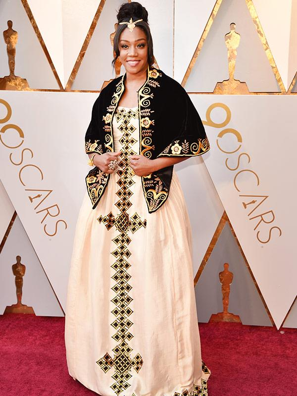 "Tiffany Haddish says her incredible Oscars' gown was inspired by her late father. ""There have been really awesome, really great times and some bad times. My father passed away this year and he's from Eritrea,"" she told *E!* on the red carpet."