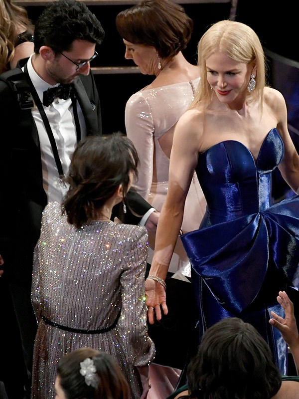 "Following her [stunning red carpet arrival,](https://www.nowtolove.com.au/fashion/red-carpet/nicole-kidman-2018-oscars-red-carpet-arrival-45425|target=""_blank"") Nicole Kidman rubs shoulder with Sally Hawkins."