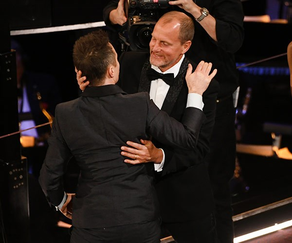 Co-star Woody Harrelson couldn't be more proud of Sam Rockwell as he wins a best supporting actor gong for *Three Billboards Outside Ebbing, Missouri*.