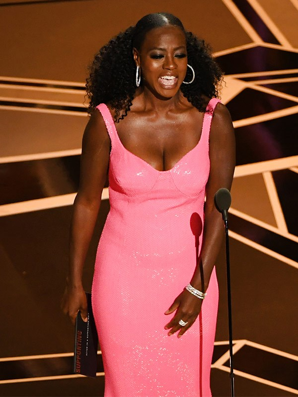 Viola Davis takes to the stage to present the Best Supporting actor award.