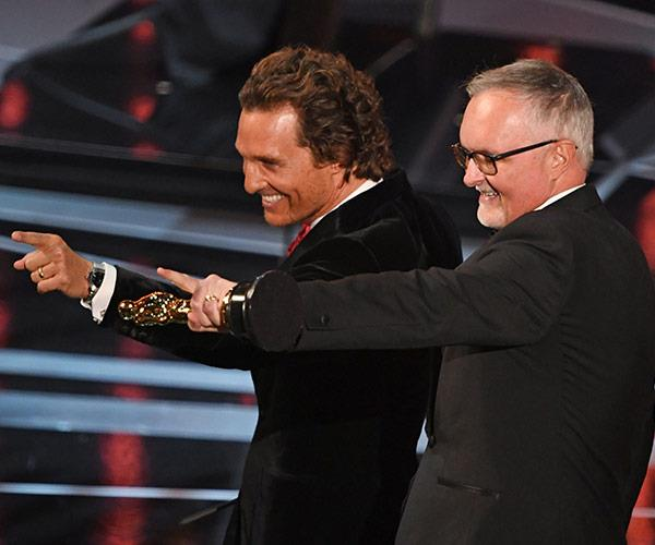 Aussie editor Lee Smith is presented his Oscar by Matthew McConaughey.