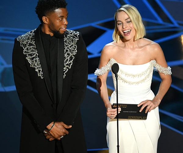 Actor Chadwick Boseman and actress Margot Robbie present the Oscar for Best Adapted Screenplay.