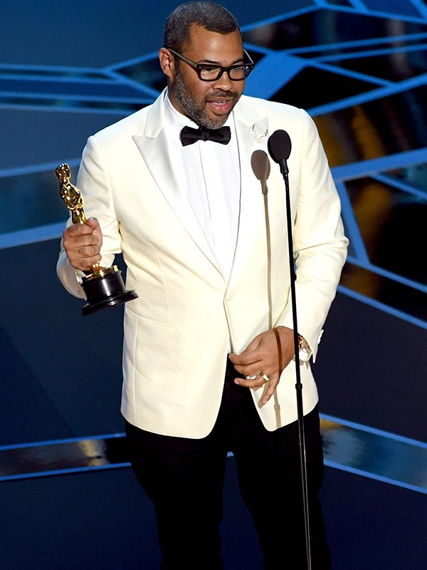 Making history! *Get Out* writer Jordan Peele picks up the Oscar for Best Original Screenplay. He is the first-ever black person to win this award.