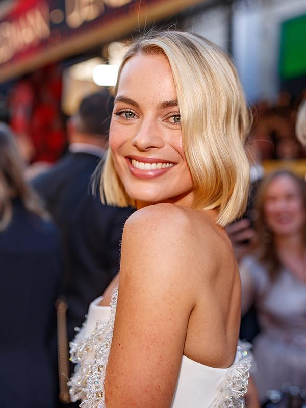 Margot was all smiles on the red carpet.