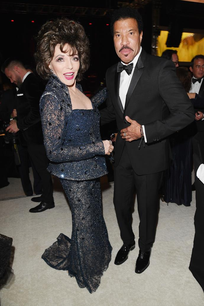 Dame Joan Collins and Lionel Richie are showing everyone how to have a good time at Elton John's Oscars after party.