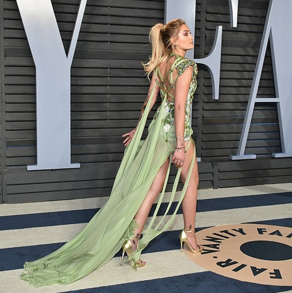 Now that's an entrance! Paris Jackson, 19, sashays across the media wall on her way to the exclusive Vanity Fair after party.