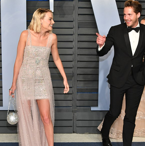 Aussie actress Margot Robbie and her husband Tom Ackerley put on a cute display as they arrive at the Vanity Fair's Academy Awards after party.