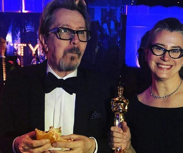 Gary Oldman tucks into a well deserved burger!