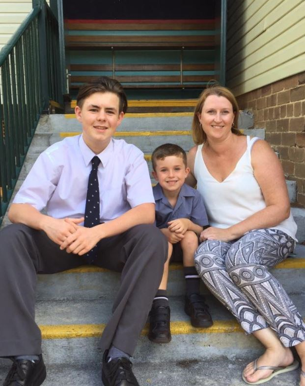 Erin and her step-son, Josh (left), picking her son, Ethan, up from his first day of school.