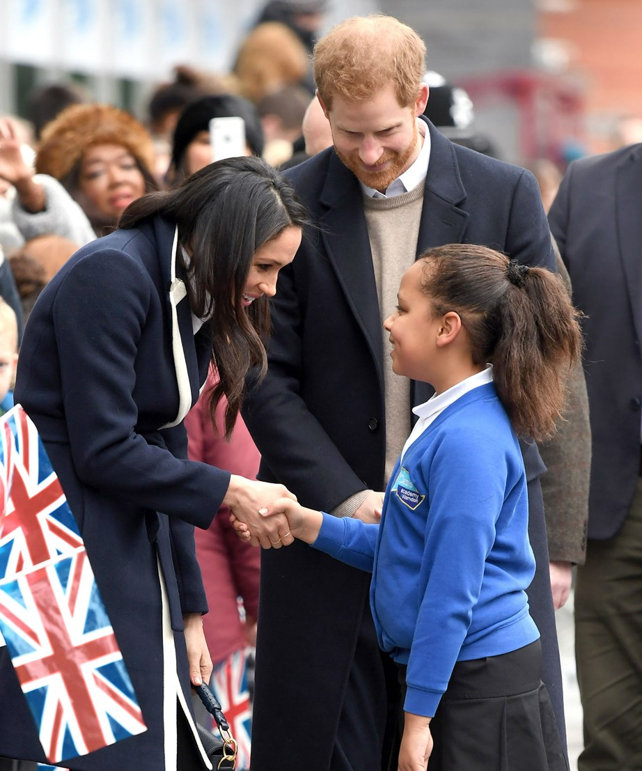 Both Meghan and Harry have a way with children. Here, they inspire a young fan in Birmingham.