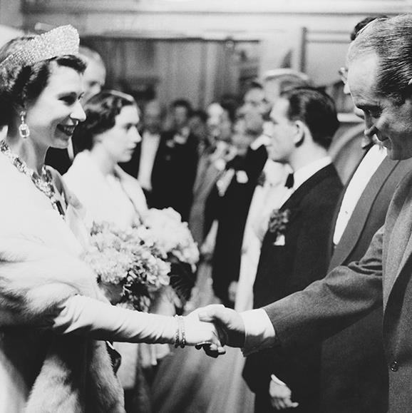Her Majesty Queen Elizabeth II of England wearing the Kokoshnik tiara when meeting actor Bob Hope.