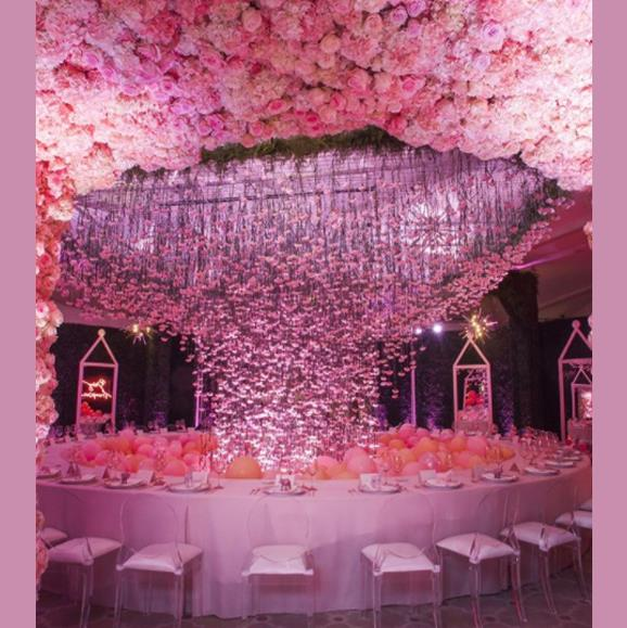 Now *that's* a centerpiece! Blooms cascaded from the ceiling, creating a sea of pink to celebrate Khloe's unborn daughter.