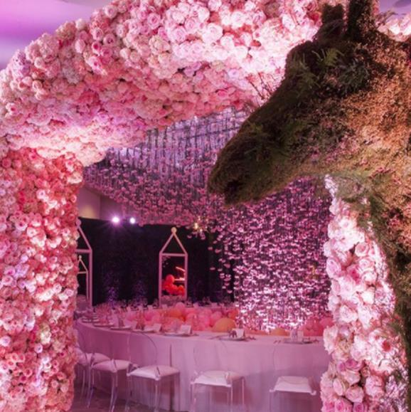 An archway of pink roses led guests into the spectacular dining area.