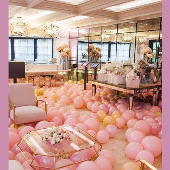 Hundreds of pink and peach balloons decorated the lavish Hotel Bel Air.