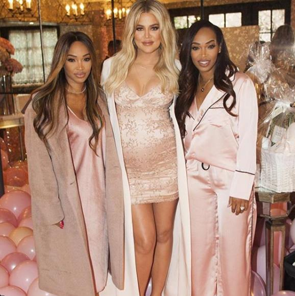 Khloe's long-time friends twins Malika and Khadijah Haqq supported the pregnant star at the event which fell on their birthday. Khloe arranged cakes for them both during the party.