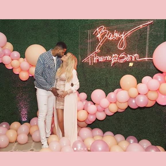 Khloe and Tristan put on a loved-up display at the baby shower.