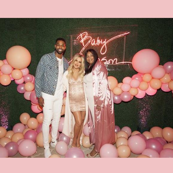 Tristan Thompson, Khloe Kardashian and Tristan's mother pose at the lavish affair.