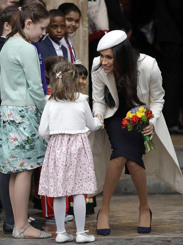 She's got the royal handshake down pat!