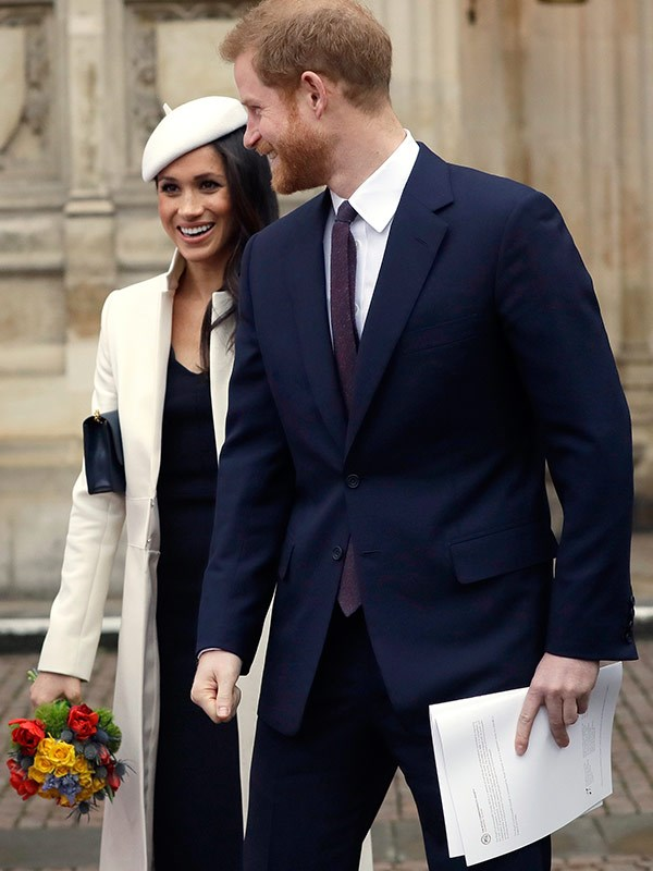 Meghan loves designer goods - including this almost-$2000 Amanda Wakeley coat.
