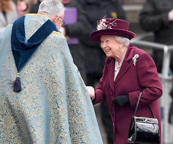 The Queen was radiant in burgundy!