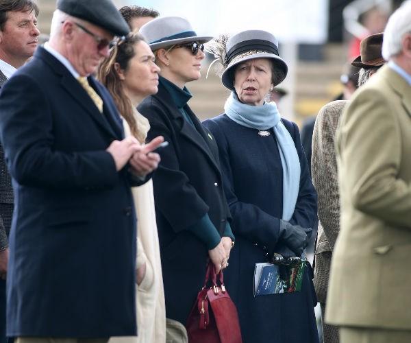 The Queen's granddaughter kept her growing baby bump cosy in an oversized coat.