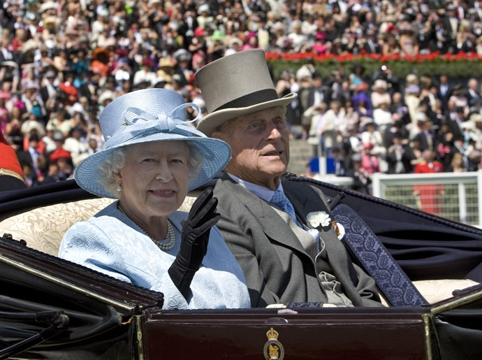 Her majesty waves to crowds as she arrives for Ladies Day At Royal Ascot, Berkshire in 2008 wearing her silk, baby blue ensemble yet again.
