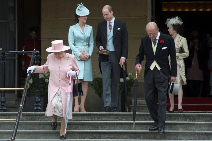 Queen Elizabeth II and Prince Phillip, Princess Anne, Duchess Catherine and Prince William arrive at a garden party at Buckingham Palace in May 2017. Kate reached *way* back in her closet for this nearly five-year old pastel blue silk-satin coat dress which she paired with a hat by Lock & Co.