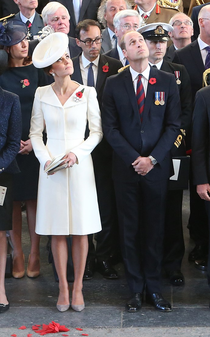 This coat is too gorgeous to leave in the wardrobe, Kate wore it again on the 100th anniversary of the Battle of Passchendaele in July, 2017. Here the Duke and Duchess of Cambridge watch as the poppies fall from the roof of the Menin Gate in Ypres, Belgium.