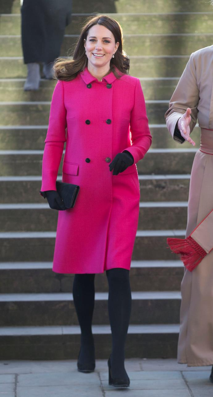 Accessorising this time with black gloves and tights, the Duchess stepped out in the statement coat again in March this year.