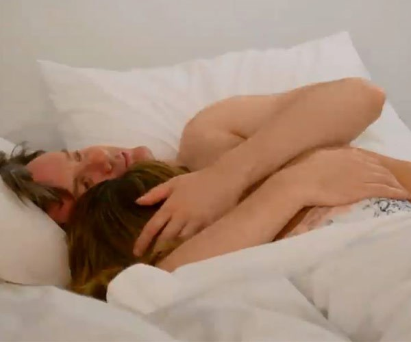 Pillow talk: Troy cuddles up to new flame Carly in bed.