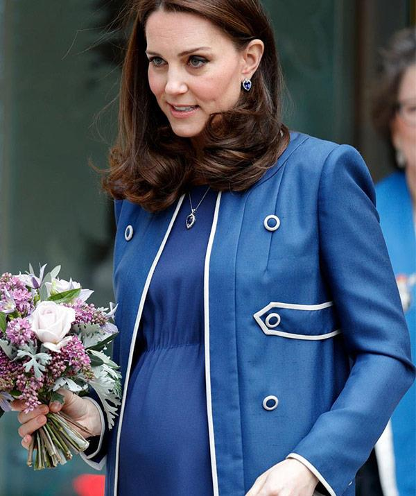 A subliminal sign? The bookies are convinced she's having another son after she kept dressing in blue ensembles.