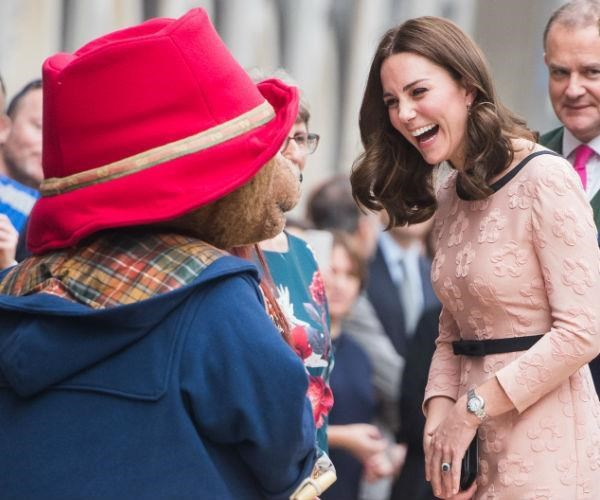 Just a week or so later, Duchess Catherine stepped out in this delightfully apricot and black-trimmed dress for an impromptu dance with Paddington Bear.