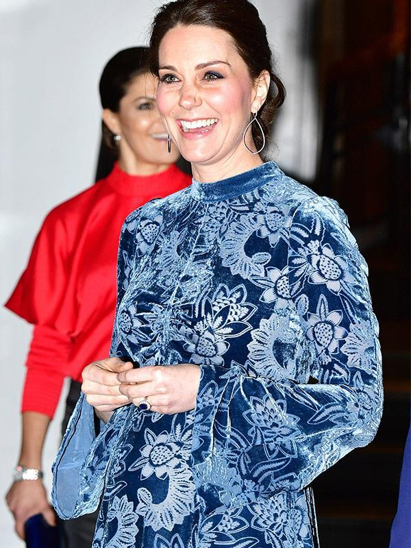 February 1 and the Duchess is having FUN! The Duchess has played to her love of prints in this blue velvet, flared-sleeved frock at the Fotografiska Gallery in Stockholm.