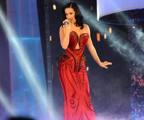 "*Katy Perry*   The US singer's 2011 performance of ""Firework"" was as you'd expect – explosive. Smoke swirled about  as the the gorgeous brunette took to the stage in a fiery red dress. The star was backed by an orchestra to belt out the hit song for an unforgettable performance."