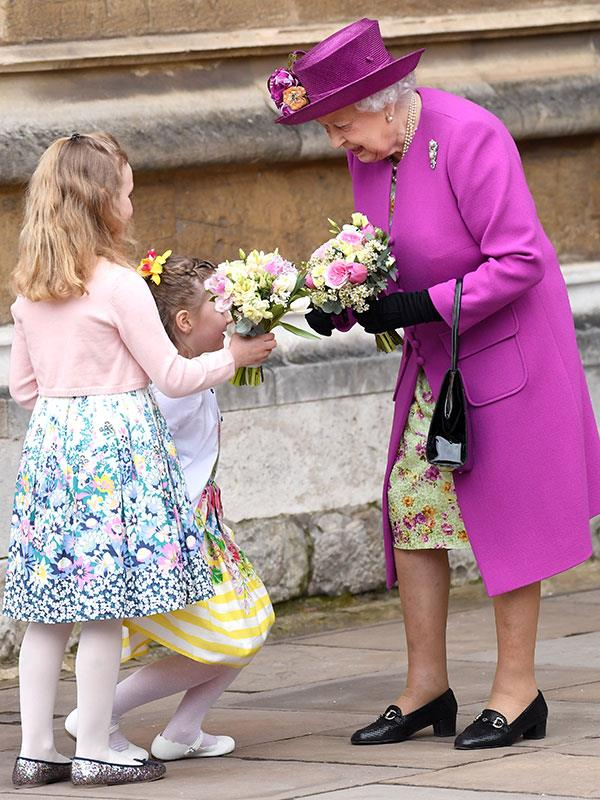 Her Majesty receives bouquets from her little fans.