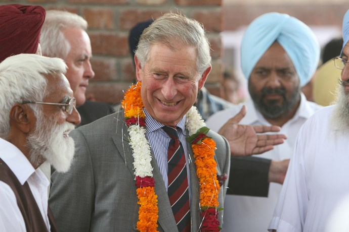 Charles visiting Hansali Farm in Chandigargh, India while touring the country for the Delhi Commonwealth Games in 2010.