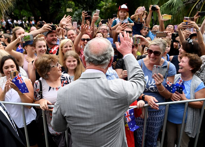The Queensland rain wasn't going to deter avid Royal fans from seeing Charles.