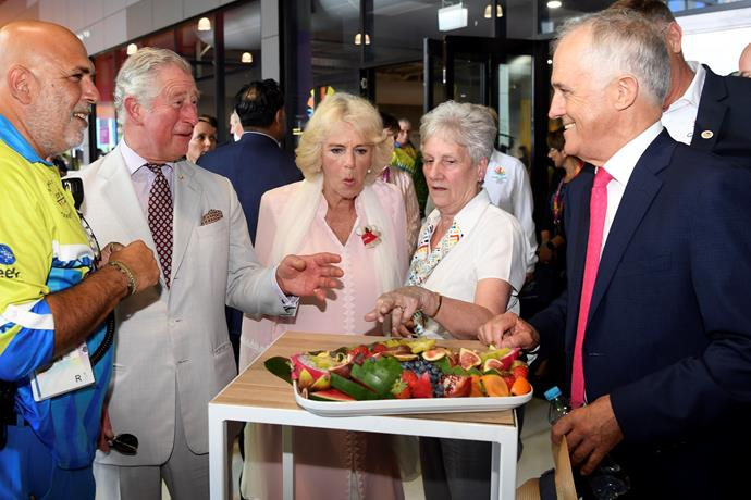 Charles and Camilla having a chuckle with the PM over a quintessentially Australia fruit platter.
