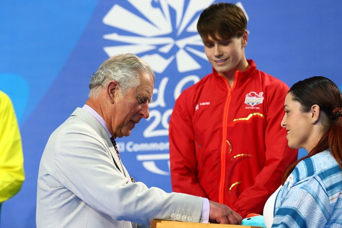 The Prince presenting medals to worthy swimming recipients at the Commonwealth Games.