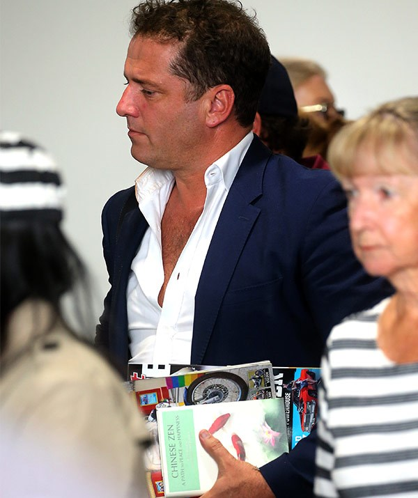 The *Today* star cut a lonely figure at the airport, with his self-help book in tow.