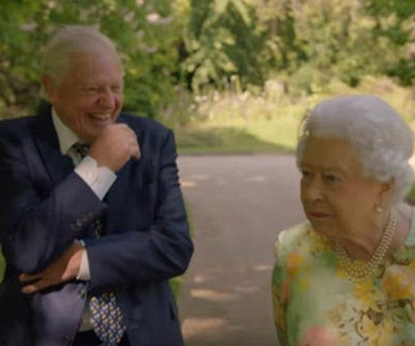 The Queen's off-the-cuff gags had Sir David in a fit of giggles.