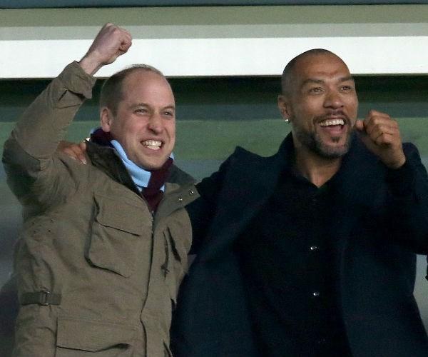 There, he sat alongside former Villans striker John Carew before mingling with fellow fans.