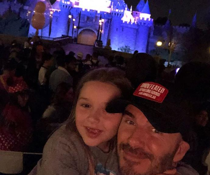 She's a daddy's girl! Harper clings tight to her Dad as the family watch the spectacular Disneyland fireworks display.