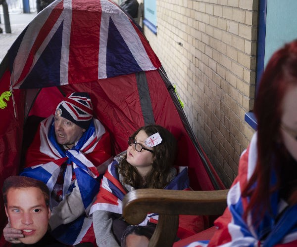 They're armed with costumes and royal paraphernalia as well as warm blankets and tents to combat the cold temperatures.