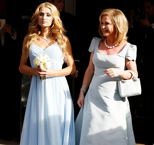 Paris Hilton looking georgeous wearing custom made Dennis Basso pale blue chiffon gown and silver heels whilst attending her sister, Nicky's wedding.